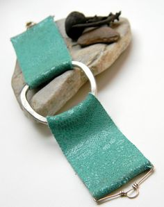 Nice color and handy work    Snakeskin Embossed Turquoise Leather and Brushed by UrbanEclectic