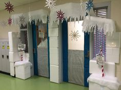 Winter Wonderland Classroom Door Decoration. I had many styrofoam coolers. I used a styro-cutter to cut through styrofoam and make igloo pieces. I was even able to carve out room numbers, initials and icicles. Then on the back of some pieces, I created a groove, and placed battery operated lights to illuminate sections.  I used magnets to secure pieces around doorframe and to hang awning. It was a fun