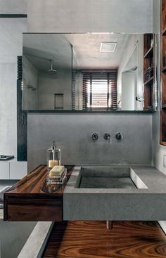 Love the dark wood accent with polished concrete #masterbath