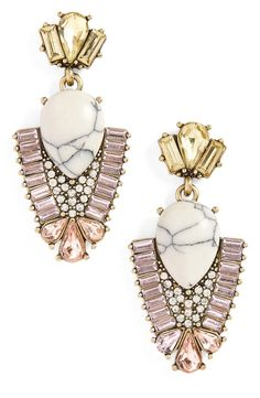 Dramatic stones are set off with a lavish assortment of sparkling crystals on drop earrings with a vintage-chic look.