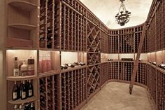The wine cellar, with its barrel-vaulted ceiling and unique climate control, is equipped to hold several thousand bottles.