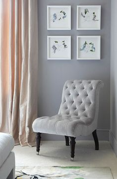 A chair by George Smith makes a comfy spot to read. Silk draperies in blush keep the room looking soft - Traditional Home®