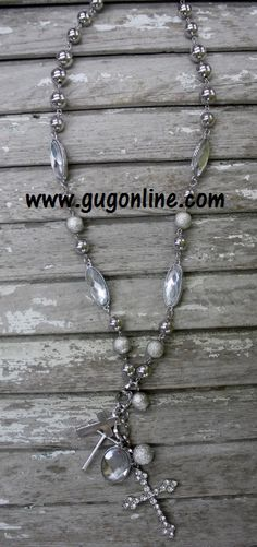 Beautiful Long Textured Silver Beaded Necklace with Large Crystal Cross and Charms www.gugonline.com Price:$19.95