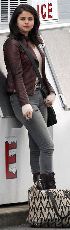 Selena Gomez's red leather jacket, lace boots, and white print handbag street style id