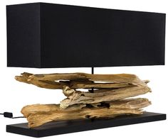 Pure nature! Pieces of wood are skilfully stacked on the solid base to form an original table lamp