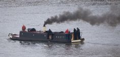 Narrowboat 'Hasty' puffing it's way up river from Limehouse basin to join the Regents Canal.