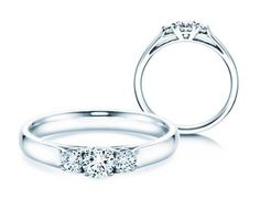 Verlobungsringe 3 Stones: Ring mit drei Diamanten.  Aus der vergangenen, jetzigen und den Erwartungen an die zukünftige Liebe entwickelt sich die Wirklichkeit einer Partnerschaft. Drei Diamanten symbolisieren diese drei Zeitebenen und verbinden sich im Modell 3 Stones zu einem bedeutsamen und romantischen Liebesbeweis.
