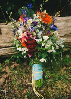 Wildflower bouquet --- LRD: Lots to like - purples, blues, reds, oranges...  don't like the tie here