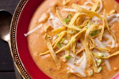 This hearty chicken tortilla soup recipe is thickened with corn tortillas and is full of shredded chicken, peppers, tomatoes, and chili spices.