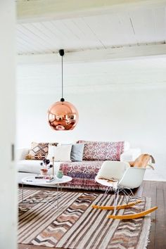 love the idea of a modern lamp and a more rustic carpet, it is in the mix..