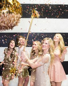 Pink and gold wedding details: You can't have a pink and gold wedding and not take advantage of metallic confetti. Use it in a pinata at the reception, or as your exit toss (large pieces generally photograph better).
