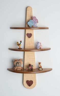 This tiered display shelf is easy to scroll and mount with heart-shaped covers that hide unappealing screws. Order Scroll Saw Woodworking & Crafts Winter/Spring 2016 (Issue at scrollsawer. Learn Woodworking, Easy Woodworking Projects, Popular Woodworking, Woodworking Furniture, Diy Wood Projects, Wood Crafts, Woodworking Plans, Woodworking Logo, Woodworking Articles