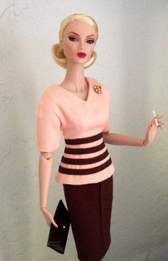 I know she isn't a Barbie doll, but I've never seen a doll smoking, although this one is quite fabulous:-)