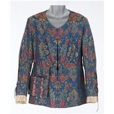 """(20th Century Pictures, 1934) Blue damask with yellow, pink, orange and light blue floral print lace up tunic and matching satchel.  Designed by Gwen Wakeling. Worn by Fredric March as """"Benvenuto Cellini"""" when he comes to deliver the key to the Duchess (Constance Bennett) in Affairs of Cellini."""