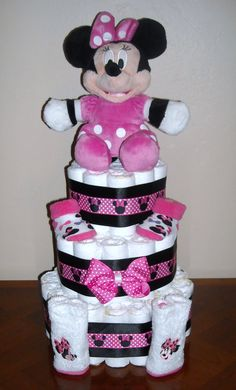 Minnie Mouse Diaper Cake. $60 Check out my other diaper cakes at http://www.facebook.com/CushieTushieCakes