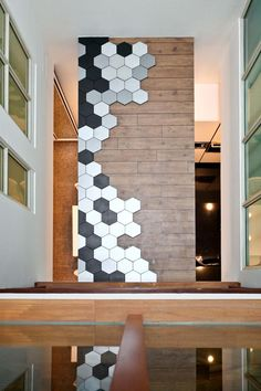 Mixed Materials: Take cue from these owner who used a mix of wood and metal panels to create a feature wall. The hexagonal panels also light up at night.
