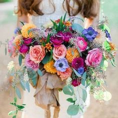 Bring a touch of colour into your wedding ceremony... What a beautiful bouquet!