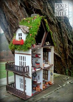 This minature house is only 18 inches tall with a 10.5 x 7 inch base. Incredible.