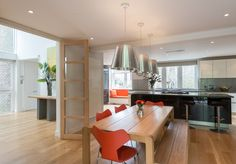 Airy double-height hall leads to living area (West Hill Park, London — The Modern House Estate Agents: Architect-Designed Property For Sale in London and the UK) Dining Area, Dining Rooms, Saarinen Chair, Hill Park, Modern Door, Fritz Hansen, Estate Agents, Modern Interiors, Wooden Tables