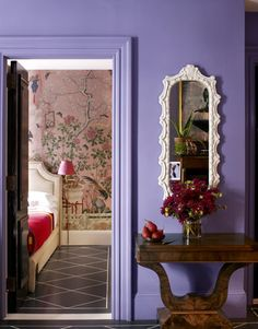 mirror on a purple wall  - HouseBeautiful.com        Bi fold doors take up half the space.  Would it work for 'den'