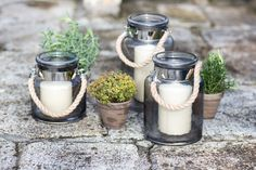 Rope handle lanterns are a stylish and elegant addition to any Outdoor Entertaining, New Furniture, Glass Of Milk, Lanterns, Outdoor Living, Garden Ideas, Handle, Dinner, Elegant