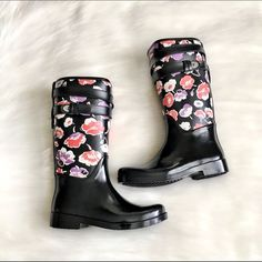 🚫FINAL PRICE🚫Black Coach Floral Rainboots Brand new with box - perfect condition! Adorable floral print. Comes with original packaging and box. Materials: rubber & canvas upper. Rubber sole. Silver plated hardware. 100% authentic. 💔No trades/off Posh transactions ❣Final price unless bundled❣ Coach Shoes Winter & Rain Boots