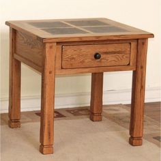 Enhance your home decor with the Rustic Slate-top Oak End Table. This table features a traditional design with natural slate accents that add a unique touch that you will love.