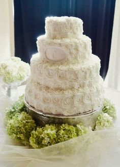 Buttercream wedding cake with rosettes and monogram