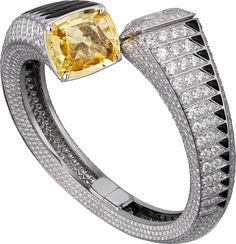 CARTIER. High Jewellery visible hour watch, one 19.20-carat cushion-shaped yellow sapphire, obsidian, brilliant-cut diamonds, quartz movement. #Cartier #CartierRoyal #2014 #HauteJoaillerie #HighJewellery #FineJewelry #YellowSapphire #Obsidian #Diamond