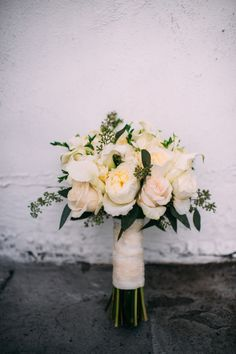 Classic cream colored bouquet: http://www.stylemepretty.com/new-york-weddings/new-york-city/2016/04/14/this-chic-nyc-wedding-is-all-sorts-of-breathtaking/ | Photography: Jessica Oh - http://www.jessicaohphotography.com/