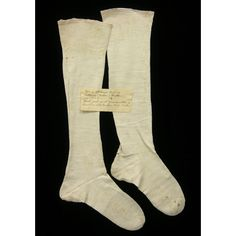 """Women's Knit Linen Stockings  ca. 1782  Origin: America, Pennsylvania, Philadelphia  OL each 20""""; Foot length 10 ¼""""  Linen, knitted; silk marking stitches  Acquisition funded by the Friends of Colonial Williamsburg Collections  Acc. No. 2009-43,4A"""