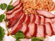 12 oz pork tenderloin 1/4 cup soy sauce 2 tablespoons red wine 1 tablespoon honey 1 tablespoon brown sugar 2 teaspoon red food color 1 clove garlic 1 spring onion  Combine ingredients and use as a marinade for the pork. Cook at 350 degrees for 30 minutes, turning frequently and base with marinade.