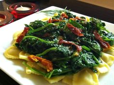 DJ Dave Diner 7/29 Basil Mezzaluna Florentine - Mostly meatless Monday with lots of green, and I've been thinking about Italian all day. Fresh basil filled mezzaluna, with spinach sautéed in oregano infused EVOO and a touch of bacon fat, plus garlic and S+P. Topped with more basil, sun dried tomatoes, a touch of truffle oil for flavor and Parmesan. Molto bene!