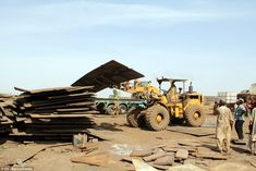 Metal : Steel plating from ships' hulls is stacked into a pile prior to being loaded onto trucks and hauled off to be sold for scrap Oil Rig Jobs, Ship Breaking, Cheap Cruises, Heavy Machinery, World's Biggest, Sandy Beaches, Monster Trucks, Scrap, Vacation