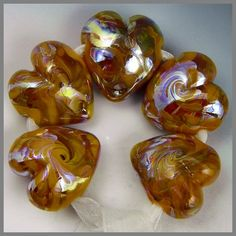 a set of five opaque amber hearts handmade lampwork beads with swirled iridescent colors - Butter Amber Hearts