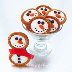 These Frosty Snowman Pretzels are adorable! The fruit roll up ties are so cute.