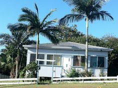 It's like a Grand Queenslander, but without the 'Grand' or the 'Queenslander'. Just a wonderful fibro shack with excellent feature palms. And an amazing view. And it's for sale. We Built This City, Queenslander, Beach Shack, Good House, House Plans, Shed, Australian Beach, Exterior, Beach Houses
