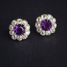 Antique amethyst and diamond halo studs set in bright yellow gold. #joganibh…