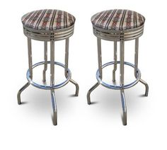 29'' Specialty Chrome Barstools (2 Stools) (Native) by The Furniture Cove. $144.87. Chrome Metal Finish. Set of 2 Bar Stools. These are new 29'' chrome barstools that have footrests and a swivel seat. The seats feature Native American Indian Tribal Themed upholstery. The sides of the seat have nice metal work and there are feet protectors on the bottom of each leg. These are great for kitchen or shop, or spread around a game room or patio setting. In this listing you will re...