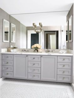 Nice balanced double vanity for Master except with laundry hamper drawer?  Cabinetry by Davila Woodwork