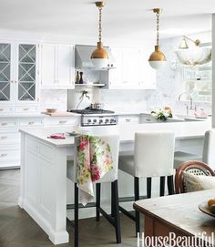 Beautiful white and gray kitchen with brass accents