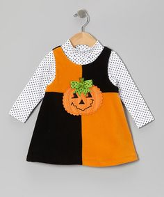 With a richly embroidered pumpkin appliqué and a playful silhouette, this fuzzy fleece jumper and polka dot top will turn any day into a festive delight. Size note: Infant sizes include bodysuit in place of top.