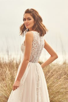 Lillian West wedding dresses embody whimsy and romance. From soft, patchwork laces to flowing silhouettes, Lillian West is perfect for the free-spirit bride. Lillian West, Lace Wedding Dress, Dream Wedding Dresses, Bridal Dresses, Wedding Gowns, Wedding Shoes, High Neck Lace Top, Stella York, Chiffon Skirt