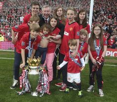 Sir Alex Ferguson celebrates with his grandchildren and the Premier League trophy Manchester United Champions, Manchester United Football, Man Utd Squad, Cristiano Ronaldo Lionel Messi, Neymar, Official Manchester United Website, Barcelona Soccer, Fc Barcelona, Sir Alex Ferguson