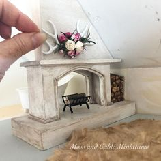 I am impossibly impatient! I haven't painted the walls or decided on floors yet but I'm ready to decorate. This fireplace divides the Master bedroom from the bathroom. I'm aiming for rustic but divine 💕🖤😆 Wooden Dollhouse, Victorian Dollhouse, Dollhouse Dolls, Dollhouse Miniatures, Miniature Crafts, Miniature Houses, Miniature Dolls, Miniature Furniture, Dollhouse Furniture