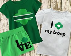 """Show off your love for scouting with this set of trefoil designs. Includes 3 Girl Scout inspired designs: • The word """"LOVE"""" set on a square with a trefoil in place of the O • A trefoil with a split in the middle for you to add your own text • The phrase """"I [heart] my troop"""" with a trefoil surrounding the heart"""