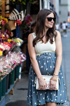 Very cool maternity wear. Love the flower market in the background.