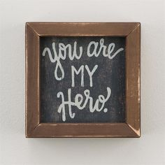 "Give this 'You Are My Hero' wood framed board to the hero in your life! Looks great displayed on a desk or nightstand. Dimensions: 6"" x 6"" IN STOCK"