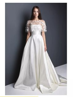 Pan satin strapless gown with a lace cape like bodice loosely fitted over the shoulders