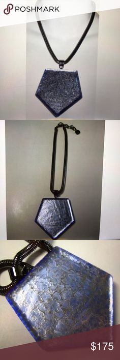 PONO Joan Goodman Necklace PONO Joan Goodman Gunmetal Reflective Pendent Necklace. Reflective flower craved pendant with gun metal snake chain and lobster closure. Made in Italy . Worn by celebrities. Condition: New Pono Joan Goodwin Jewelry Necklaces